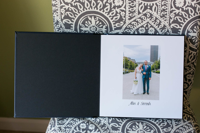 A navy leather wedding album by Maria Sharp Photography.